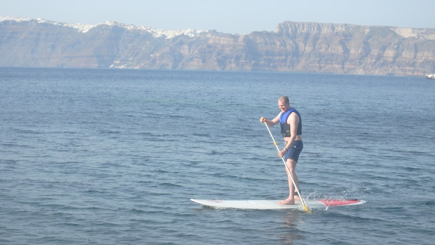 SUP with Santorini in the background