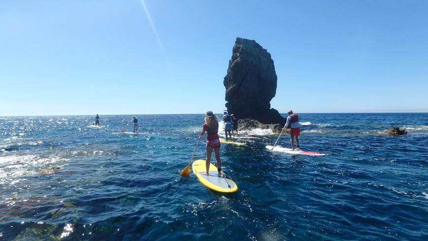 SUP around a Rock in the middle of the sea